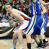 Illinois State Marley Hall (41) tries to figure out how to get around the defense of Indiana State Andrea Radenmacher (32) and make her way to the basket in the second half of their second round MVC tournament game.  Indiana State defeated Illinois State 80-51.