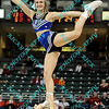 An Indiana State cheerleader performs during the first half of an opening round MVC tournament game.