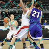 Bradley guard Hanna Muegge (5) get set for a shot while teammate MacKenzie Westcott (32) blocks out Evansville forward Meagan Collins (21) early in the first half of their MVC first round tournament game.  Bradley was leading Evansville 35 to 30 at half.