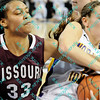 During the 2011 MVC tournament championship game Missouri State Christiana Shorter (33) and Northern Iowa Amber Kirschbaum (0) battle for a rebound in the first half.  At halftime Northern Iowa was leading Missouri State 35-15.