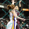 During the 2011 MVC tournament championship game Missouri State Jasmine Malone (12) puts up a shot over the defense of Northern Iowa Jacqui Kalin (10) during the first half of the game.  At halftime Northern Iowa was leading Missouri State 35-15.