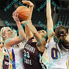 During the 2011 MVC tournament championship game in the first half Northern Iowa continues their great defense by Erin Brocka (44) and Amber Kirschbaum (0) against Missouri State Christiana Shorter (33). At halftime Northern Iowa was leading Missouri State 35-15.