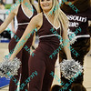 A Missouri State dance line member sports a smile as she entertains the fans during a first half time out during the semifinal MVC tournament game.