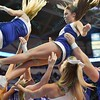 Members of the St. Louis University Saintsation cheerleaders perform a toss and catch during a conference game  between St. Louis University Billikens and the University of Massachusetts Minutemen played in St. Louis, MO. at Chaifetz Arena.  Where UMass defeated St. Louis 60-56