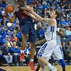 Dayton Flyers forward DYSHAWN PIERRE (21) ties to pass around the defense of St. Louis Billiken forward TANNER LANCONA (15) during a conference game  between St. Louis University Billikens and Dayton Flyers played in St. Louis, MO. at Chaifetz Arena.  Where Dayton defeated St. Louis