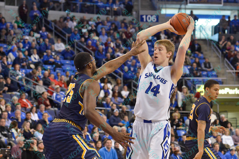 LaSalle Explorers forward JERRELL WRIGHT (25) puts a hand in the face of St. Louis Billiken forward BRETT JOLLY (14) blocking his view during a conference game  between St. Louis University Billikens and La Salle Explorers played in St. Louis, MO. at Chaifetz Arena.  Where St. Louis defeated La Salle 68--64 in OT.