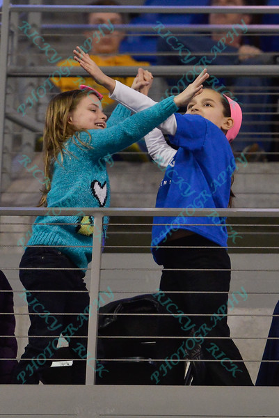 Two young girls mess up a high five attempt during a conference game  between St. Louis University Billikens and La Salle Explorers played in St. Louis, MO. at Chaifetz Arena. Where St. Louis defeated La Salle 68--64 in OT.
