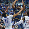 LaSalle Explorers guard JORDAN PRICE (21) pulls up in the lane to take a jumpshot over the defense of St. Louis Billiken guard MILES REYNOLDS (11) during a conference game  between St. Louis University Billikens and La Salle Explorers played in St. Louis, MO. at Chaifetz Arena.  Where St. Louis defeated La Salle 68-64 in OT.