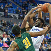St. Louis Billiken guard DAVELL ROBY (5) gets his drive to the basket stopped by George Mason Patriots forward TREY PORTER (15) and George Mason Patriots forward JALEN JENKINS (31) during a conference game  between St. Louis University Billikens and George Mason Patriots played in St. Louis, MO. at Chaifetz Arena.  Where George Mason defeated St. Louis 78-50