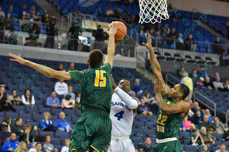 George Mason Patriots forward TREY PORTER (15) blocks the shot of St. Louis Billiken forward MILIK YARBROUGH (4) during a conference game  between St. Louis University Billikens and George Mason Patriots played in St. Louis, MO. at Chaifetz Arena.  Where George Mason defeated St. Louis 78-50