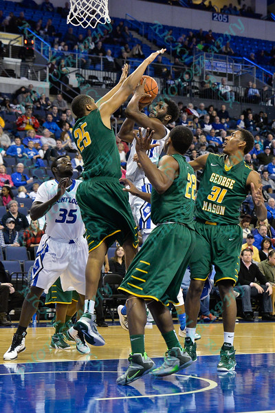 St. Louis Billiken guard DAVELL ROBY (5) gets his shot at the end of the half blocked by George Mason Patriots forward JULIAN ROYAL (25) during a conference game  between St. Louis University Billikens and George Mason Patriots played in St. Louis, MO. at Chaifetz Arena.  Where George Mason defeated St. Louis 78-50