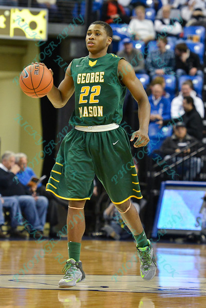 George Mason Patriots guard MARQUISE MOORE (22) brings the ball down the court during a conference game  between St. Louis University Billikens and George Mason Patriots played in St. Louis, MO. at Chaifetz Arena.  Where George Mason defeated St. Louis 78-50