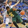 George Mason Patriots center SHEVON THOMPSON (14) puts his shoulder into St. Louis Billiken center AUSTIN GILLMANN (25) as he tries to dribble around him during a conference game  between St. Louis University Billikens and George Mason Patriots played in St. Louis, MO. at Chaifetz Arena.  Where George Mason defeated St. Louis 78-50
