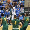 St. Louis Billiken forward REGGIE AGBEKO (35) gets inside the George Mason defense for an easy layup during a conference game  between St. Louis University Billikens and George Mason Patriots played in St. Louis, MO. at Chaifetz Arena.  Where George Mason defeated St. Louis 78-50