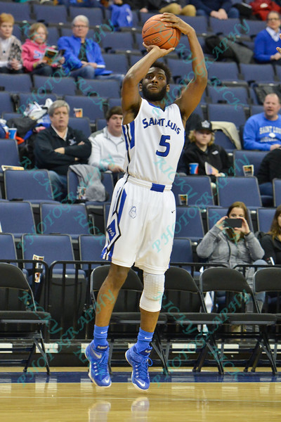 St. Louis Billiken guard DAVELL ROBY (5) takes a three point shot during a conference game  between St. Louis University Billikens and George Mason Patriots played in St. Louis, MO. at Chaifetz Arena.  Where George Mason defeated St. Louis 78-50