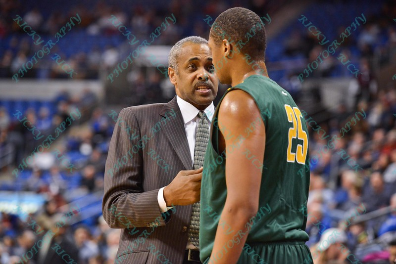 George Mason Patriots head coach PAUL HEWITT talks with George Mason Patriots forward JULIAN ROYAL (25) during a conference game  between St. Louis University Billikens and George Mason Patriots played in St. Louis, MO. at Chaifetz Arena.  Where George Mason defeated St. Louis 78-50