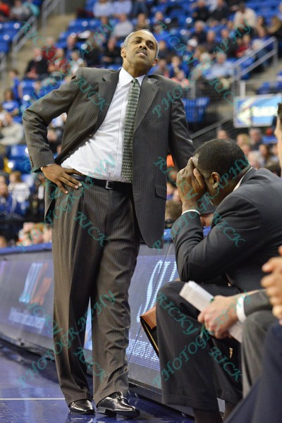George Mason Patriots head coach PAUL HEWITT turns his back, and leans against the scorers table is dismay of the play on the court during a conference game  between St. Louis University Billikens and George Mason Patriots played in St. Louis, MO. at Chaifetz Arena.  Where George Mason defeated St. Louis 78-50