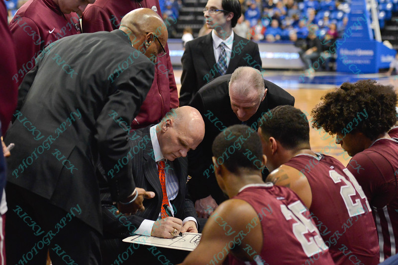 St. Joseph's Hawks head coach PHIL MARTELLI  and his assistants draw up a play during a stoppage in play of a conference game  between St. Louis University Billikens and St. Joseph's Hawks played in St. Louis, MO. at Chaifetz Arena.  Where St. Louis defeats St. Joseph 68-61
