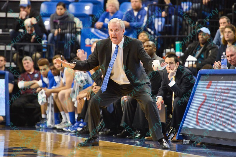 St. Louis head coach JIM CREWS gets caught up in the game and starts to play defense for his players during a conference game  between St. Louis University Billikens and St. Joseph's Hawks played in St. Louis, MO. at Chaifetz Arena.  Where St. Louis defeats St. Joseph 68-61
