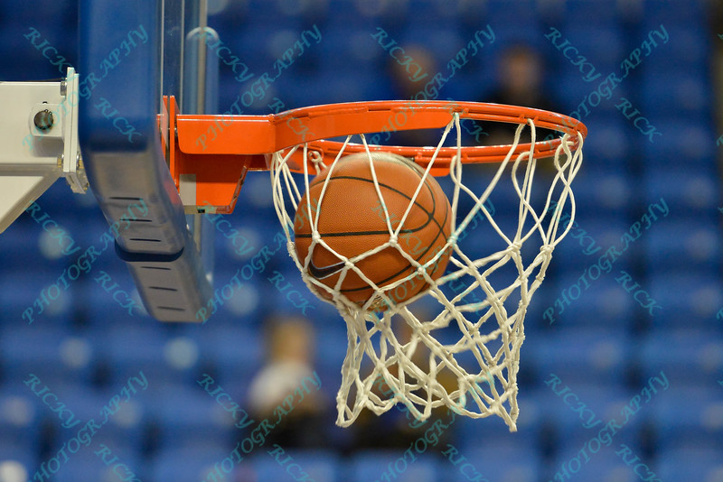 The basketball falls into the net during warmups of a conference game  between St. Louis University Billikens and St. Joseph's Hawks played in St. Louis, MO. at Chaifetz Arena.  Where St. Louis defeats St. Joseph 68-61