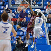 St. Joseph's Hawks forward JAMES DEMERY (25) finishes off a breakaway with a slamdunk despite the attempted defense of St. Louis Billiken guard ASH YACOUBOU (3) during a conference game  between St. Louis University Billikens and St. Joseph's Hawks played in St. Louis, MO. at Chaifetz Arena.  Where St. Louis defeats St. Joseph 68-61