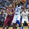St. Louis Billiken guard DAVELL ROBY (5) attempts to get a shot off against the defense of St. Joseph's Hawks guard CHRIS WILSON (24) during a conference game  between St. Louis University Billikens and St. Joseph's Hawks played in St. Louis, MO. at Chaifetz Arena.  Where St. Louis defeats St. Joseph 68-61