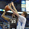 St. Bonaventure Bonnies guard ANDELL CUMBERBATCH (23) has difficulty with St. Louis Billiken center AUSTIN GILLMANN (25) while attempting a shot during a conference game  between St. Louis University Billikens and St. Bonaventure Bonnies played in St. Louis, MO. at Chaifetz Arena.  Where St. Bonaventure defeated St. Louis 64-48.