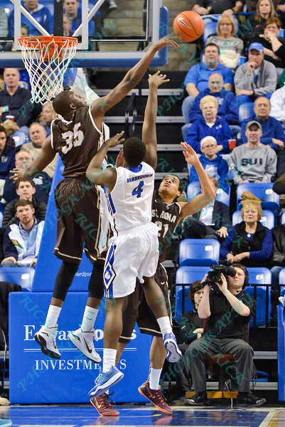 St. Bonaventure Bonnies center YOUSSOU NDOYE (35) goes high and blocks the shot of St. Louis Billiken forward MILIK YARBROUGH (4) during a conference game  between St. Louis University Billikens and St. Bonaventure Bonnies played in St. Louis, MO. at Chaifetz Arena.  Where St. Bonaventure defeated St. Louis 64-48.