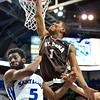 St. Bonaventure Bonnies guard IDRIS TAQQEE (1) puts a layup shot despite having St. Louis Billiken guard DAVELL ROBY (5) in his way during a conference game  between St. Louis University Billikens and St. Bonaventure Bonnies played in St. Louis, MO. at Chaifetz Arena.  Where St. Bonaventure defeated St. Louis 64-48.