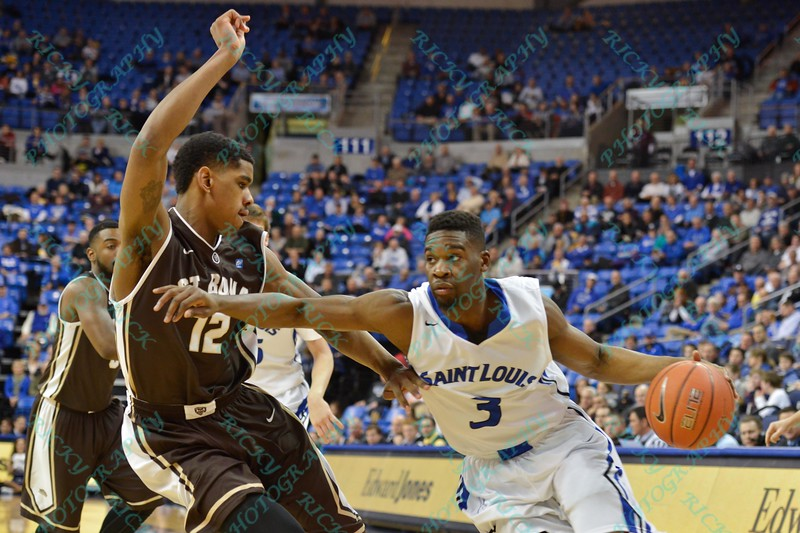 St. Louis Billiken guard ASH YACOUBOU (3) uses his arm to push past St. Bonaventure Bonnies guard/forward DENZEL GREGG (12) during a conference game  between St. Louis University Billikens and St. Bonaventure Bonnies played in St. Louis, MO. at Chaifetz Arena.  Where St. Bonaventure defeated St. Louis 64-48.