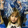 A young fan comes dressed in a Notre Dame cheerleader outfit during a conference game  between St. Louis University Billikens and St. Bonaventure Bonnies played in St. Louis, MO. at Chaifetz Arena.  Where St. Bonaventure defeated St. Louis 64-48.