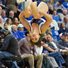 A member of the St. Louis University Saintsation cheerleaders does a back flip during a conference game  between St. Louis University Billikens and St. Bonaventure Bonnies played in St. Louis, MO. at Chaifetz Arena.  Where St. Bonaventure defeated St. Louis 64-48.