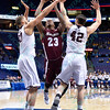 Southern Illinois Salukis forward BOLA OLANIVAN (23) tries to put a shot up between the defense of Missouri State Bears forward CAMYN BOONE (30) and Missouri State Bears forward CHRISTIAN KIRK (42) at the Missouri Valley Conference, Arch Madness Tournament game one where S. Illinois defeated Missouri State 55-48