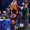 A member of the Southern Illinois cheerleader goes tumbling upside down at the Missouri Valley Conference, Arch Madness Tournament game one where S. Illinois defeated Missouri State 55-48