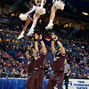 The Missouri State cheerleader perform at the Missouri Valley Conference, Arch Madness Tournament game one where S. Illinois defeated Missouri State 55-48