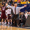 Southern Illinois head coach BARRY HINSON jumps up and down with excitement at the Missouri Valley Conference, Arch Madness Tournament game one where S. Illinois defeated Missouri State 55-48