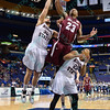Southern Illinois Salukis forward BOLA OLANIVAN (23) goes between Missouri State Bears forward CAMYN BOONE (30) and Missouri State Bears guard DORRIAN WILLIAMS (23) in an attempt to grab a rebound goes between  at the Missouri Valley Conference, Arch Madness Tournament game one where S. Illinois defeated Missouri State 55-48