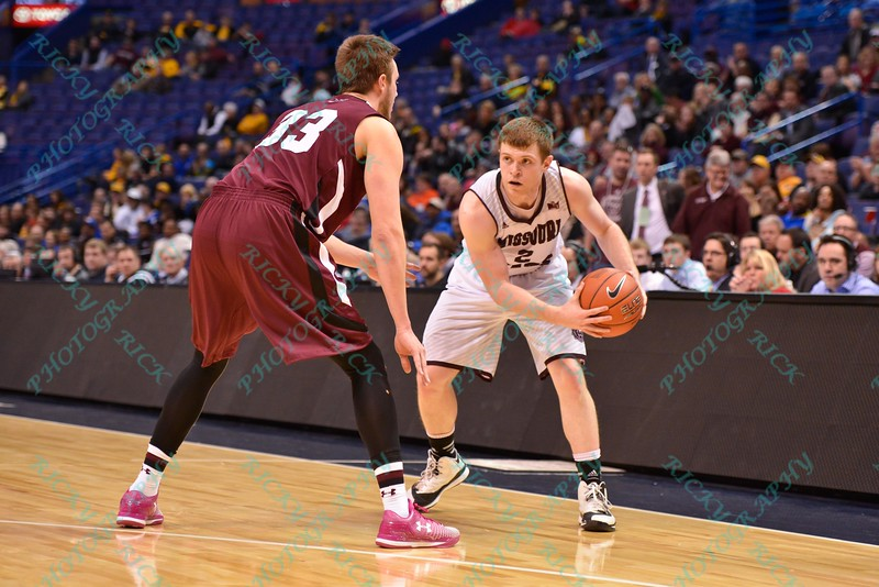 Missouri State Bears guard AUSTIN RUDER (2) looks to make a play while being defended by Southern Illinois forward SEAN O'BRIEN (33) at the Missouri Valley Conference, Arch Madness Tournament game one where S. Illinois defeated Missouri State 55-48