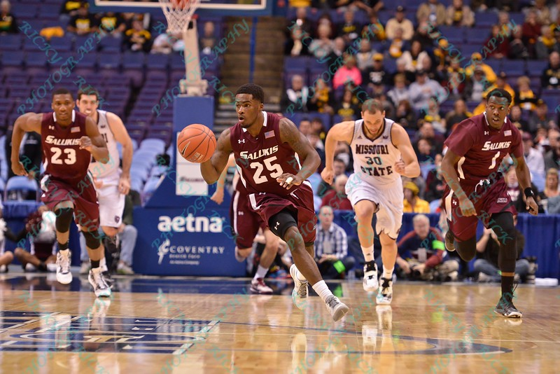 Southern Illinois Salukis guard ANTHONY BEANE (25) starts a fast break the other direction at the Missouri Valley Conference, Arch Madness Tournament game one where S. Illinois defeated Missouri State 55-48