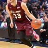 Southern Illinois Salukis guard CHAZ GLOTTA (13) drives to the basket at the Missouri Valley Conference, Arch Madness Tournament game one where S. Illinois defeated Missouri State 55-48