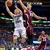 Missouri State Bears guard AUSTIN RUDER (2) gets fouled by Southern Illinois forward SEAN O'BRIEN (33) at the Missouri Valley Conference, Arch Madness Tournament game one where S. Illinois defeated Missouri State 55-48