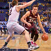 Missouri State Bears guard AUSTIN RUDER (2) ties to stop the drive to the basket of Southern Illinois forward SEAN O'BRIEN (33) at the Missouri Valley Conference, Arch Madness Tournament game one where S. Illinois defeated Missouri State 55-48