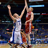 Bradley Braves center NATE WELLS (52) puts a hook shot up and over Drake Bulldogs center JACOB ENEVOLD JENSEN (11) at the Missouri Valley Conference, Arch Madness Tournament game two where Bradley Braves beat Drake Bulldogs by the score of 52-50