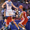 Bradley Braves guard WARREN JONES (2) passes the ball past a jumping Drake Bulldogs guard/forward CHRIS CAIRD (25) at the Missouri Valley Conference, Arch Madness Tournament game two where Bradley Braves beat Drake Bulldogs by the score of 52-50