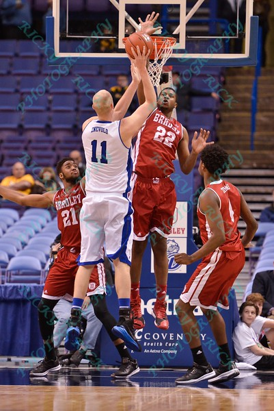 Bradley forward/center XZAVIER TAYLOR (22) attempts to block the shot of Drake Bulldogs center JACOB ENEVOLD JENSEN (11) at the Missouri Valley Conference, Arch Madness Tournament game two where Bradley Braves beat Drake Bulldogs by the score of 52-50