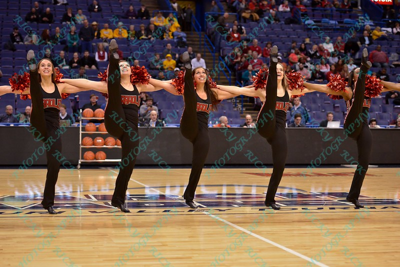 The Bradley Dance Team performs a high kick routine at the Missouri Valley Conference, Arch Madness Tournament game two where Bradley Braves beat Drake Bulldogs by the score of 52-50