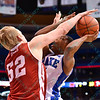 Bradley Braves center NATE WELLS (52) blocks the shot attempt of Drake Bulldogs guard KARL MADISON (1) at the Missouri Valley Conference, Arch Madness Tournament game two where Bradley Braves beat Drake Bulldogs by the score of 52-50