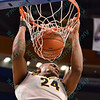 Wichita State Shockers forward SHAQUILLE MORRIS (24) slams the ball home with authority at the Missouri Valley Conference, Arch Madness Tournament game three where Wichita State defeated Southern Illinois by the score of 56-45