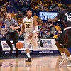 Southern Illinois Salukis guard ANTHONY BEANE (25) looks to stop the drive of Wichita State Shockers guard TEKELE COTON (32) at the Missouri Valley Conference, Arch Madness Tournament game three where Wichita State defeated Southern Illinois by the score of 56-45