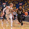 Wichita State Shockers guard RON BAKER (31) tries to cutoff the drive of Southern Illinois Salukis forward JORDAN CAROLINE (14) at the Missouri Valley Conference, Arch Madness Tournament game three where Wichita State defeated Southern Illinois by the score of 56-45